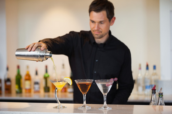 Bartender pouring cocktails at the bar