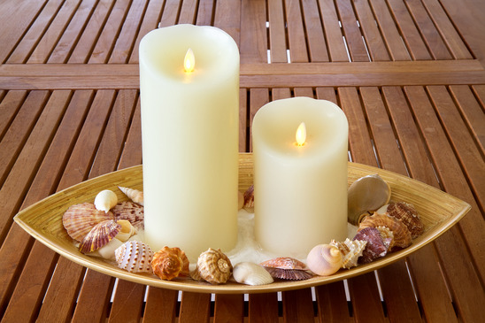Decorative candles and shells.