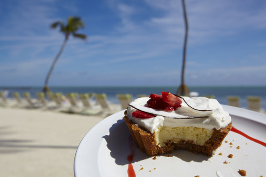 Key Lime Pie with tropical setting in the background