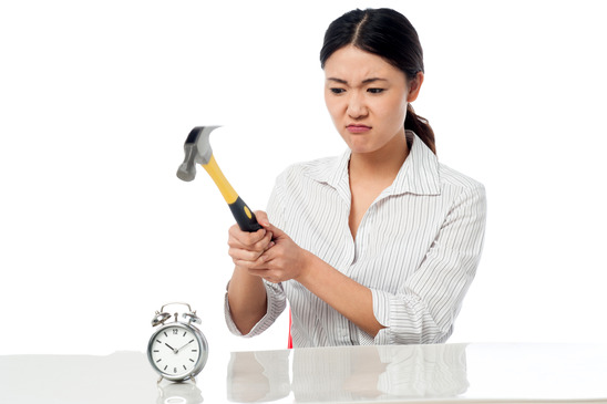photodune-5281948-frustrated-woman-smashing-an-alarm-clock-xs