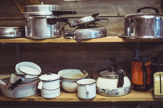 shelves cluttered with pots and pans