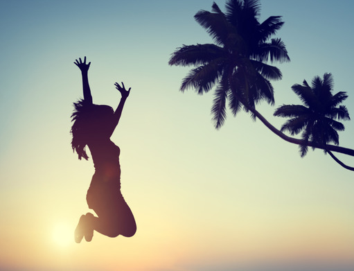 Silhouette of a Young Woman Jumping with Excitement