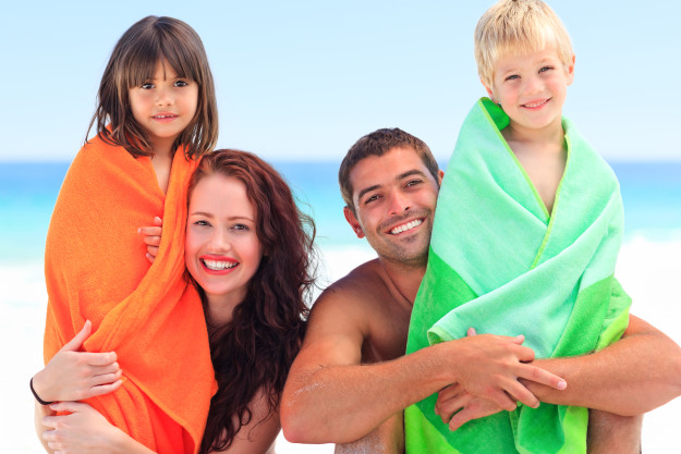 photodune-8287554-parents-with-their-children-in-towels-xl